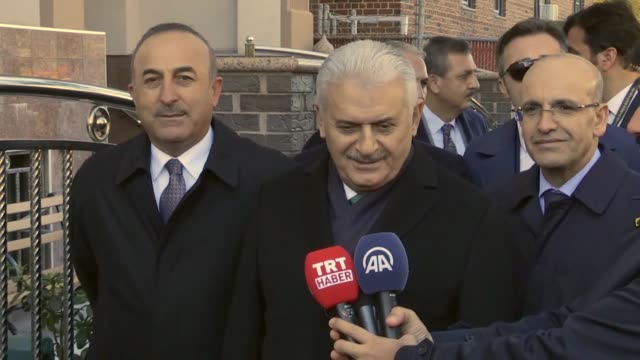 Turkish Prime Minister Binali Yildirim accompanied by Deputy Prime Minister Mehmet Simsek and Turkish Foreign Minister Mevlut Cavusoglu answers the...