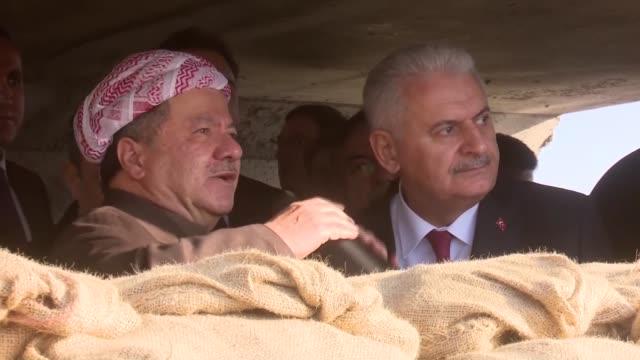 http://media.gettyimages.com/videos/turkish-prime-minister-binali-yildirim-accompanied-by-iraqi-kurdistan-video-id637939856?s=640x640