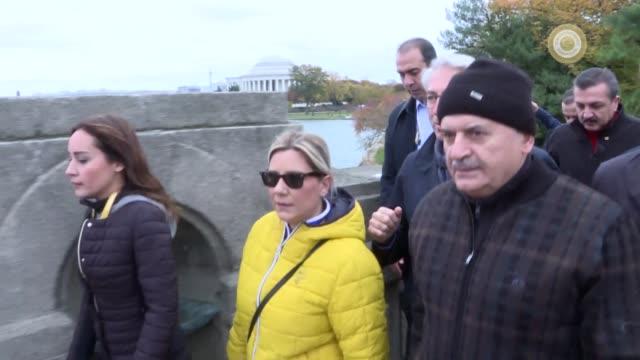 Turkish Prime Minister Binali Yildirim accompanied by Turkish Foreign Minister Mevlut Cavusoglu walks out with journalists in Washington on November...