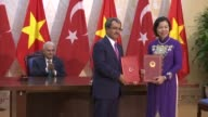 Turkish Prime Minister Binali Yildirim and his Vietnamese counterpart Nguyen Xuan Phuc attend a signing ceremony of bilateral agreements between...