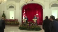 Turkish Prime Minister Binali Yildirim and Singapore's Prime Minister Lee Hsien Loong attend a joint press conference following their meeting at the...