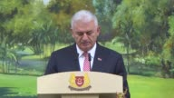 Turkish Prime Minister Binali Yildirim delivers a speech during a dinner hosted by his Singaporean counterpart Lee Hsien Loong at Istana on August 21...