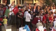 Turkish Prime Minister Binali Yildirim makes a speech as he attends the national unity march at the bridge over the Bosphorous which was renamed to...