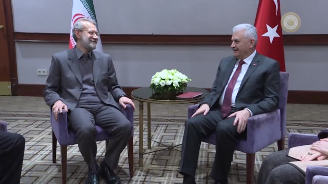 Turkish Prime Minister Binali Yildirim meets with Iranian Parliament Speaker Ali Larijani in Istanbul Turkey on November 22 2017