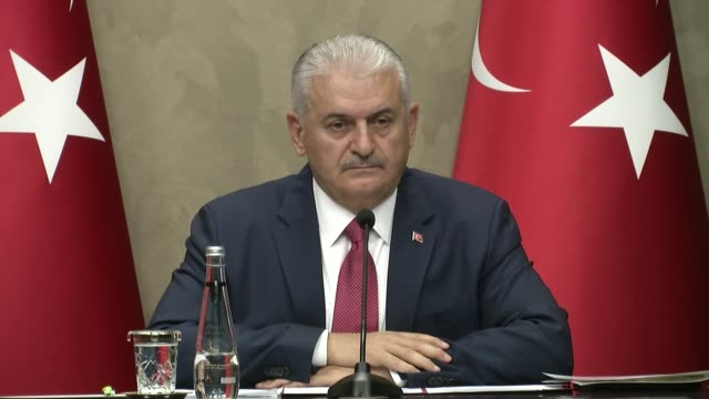 Turkish Prime Minister Binali Yildirim speaks at a press conference at Esenboga Airport in Ankara Turkey on November 07 2017 On the eve of a trip to...
