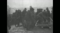 Turkish prisoners of war march on snowy landscape after being captured by the Russian Caucasus Army during the Caucasus Campaign of World War I / RCA...