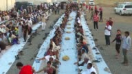 Turkish Red Crescent and Turkish Airlines distribute iftar dinner for internally displaced people from Mosul on June 10 2017 in Arbil Iraq