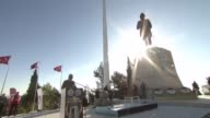 Turkish Youth and Sports Minister Akif Cagatay Kilic and first army commander full general Musa Avsever place a wreath to the monument during a...