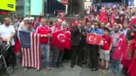 TurkishAmericans and representatives from a number of Muslim nations gather in Times Square in New York on July 15 2017 to commemorate the first...