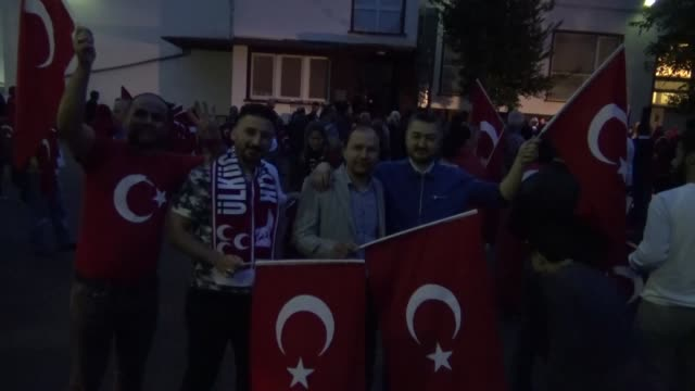Turks gather outside the Turkish Consulate General in Cologne Germany on July 15 2017 to commemorate the first anniversary of the defeated coup in...