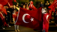 Turks gather outside the Turkish embassy in Skopje Macedonia on July 15 2017 to commemorate the first anniversary of the defeated coup in Turkey...