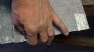 Turning works using grinding wheel, close-up