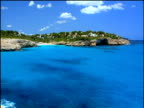 Turquoise blue sea with coast and beach in background Majorca