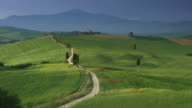 Tuscany, typical tuscan landscape of Val D'Orcia right after sunrise. Static Shot.