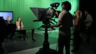 Tv presenters and crew in television studio