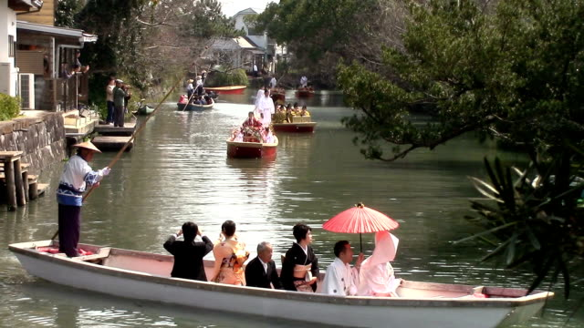 Twelve boats carrying girls decked out in gorgeous kimono like their mothers glided gracefully along a canal here March 19Japan as part of the annual...