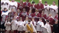 Twentieth anniversary of Hillsborough disaster Memorial service Choir singing as some scarves and flowers laid on pitch / Bishop of Liverpool...