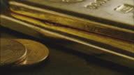 ECU, PAN, Twenty Dollar gold coins and three gold ingots