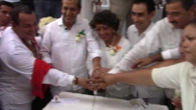 Twenty gay and lesbian couples got married in a mass wedding on an Acapulco beach on Friday one month after Mexicos top court all but legalized same...