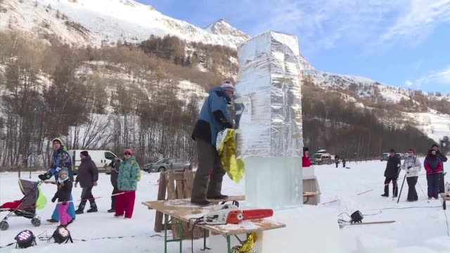 Twenty sculptors from all over the world compete for four days to give life to gigantic blocks of ice during the 26th edition of Valloire's ice...