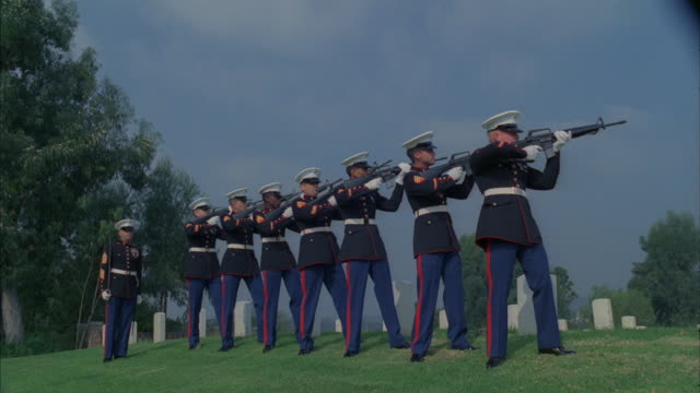 A twenty-one-gun salute executed at a military funeral.