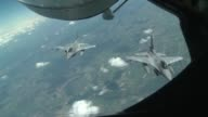 Twice a day the US military's aerial refueling aircraft the KC135 Stratotanker supplies F16 jets of several NATO countries as part of NATO's Anaconda...