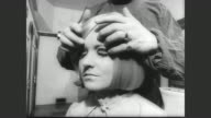 Twiggy walks into London's first wig clinic / Simon Hext wig surgeon removes wig from Twiggy's head / wig placed on pseudo operating table and teams...