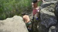 Twin Boys Climb Rocks
