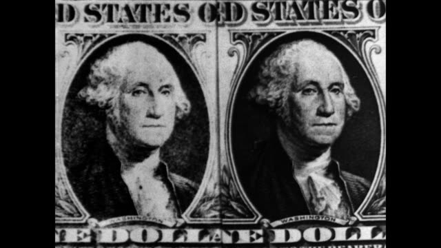 / twin secretaries typing / twins sitting together mirroring each other's movements / two paper money portraits of President Alexander Hamilton are...