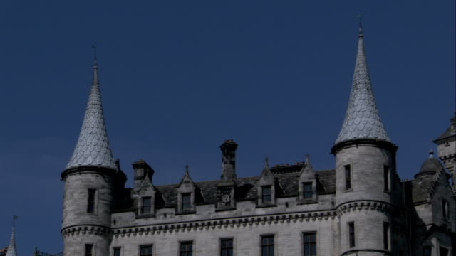 Twin spires characterize a wing of Dunrobin Castle in Sutherland, Scotland. Available in HD.