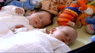 Twins born after being tested for genetic disease in embryo ENGLAND London INT Freddie and Thomas Greenstreet asleep on cot