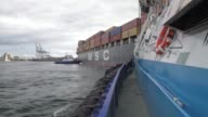 Two 300 tons/4000 horsepower tugboats from groupe Ocean assist the 70000 tons container ship Msc Patricia to dock in the Terminal Termont of the port...