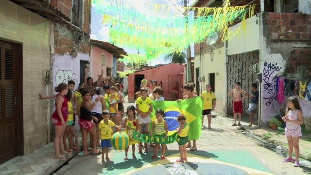 Two adjoining streets in the northern city of Fortaleza Brazil reflect the opposite views of the World Cup