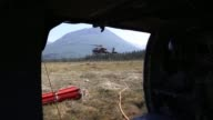 Two Alaska Army National Guard UH60 Black Hawk helicopters from 1st Battalion 207th Aviation Regiment flew a total of 200 bucket missions dumping...