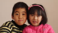 Two Asian children
