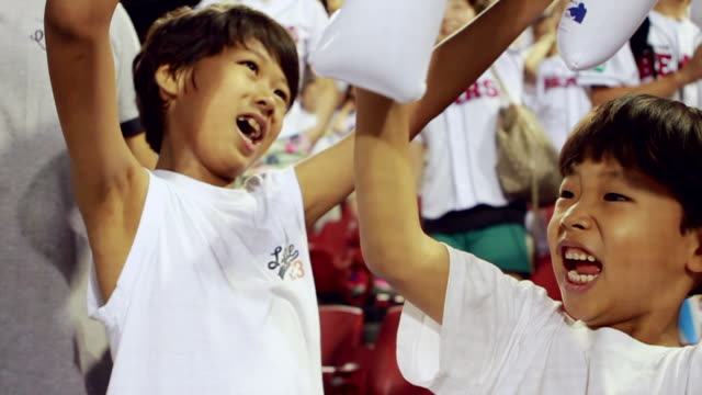 MS SLO MO Two boys cheering at stadium / Seoul, South Korea