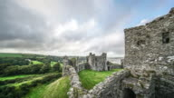 Two boys exploring Llansteffan Castle, Wales, in a time lapse.