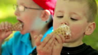 Two boys have fun eating ice cream.