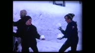 1969 two boys in snowball fight