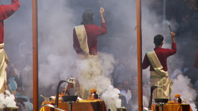 Two Brahmin Priests reform arti  with smoke with incense
