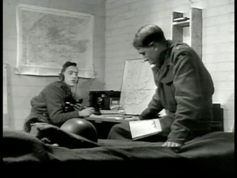 Two British radiomen 'sound the alarm' CU Alarm bell VS British soldiers playing pool chess piano rushing out NIGHT EXT VS Soldiers running to their...