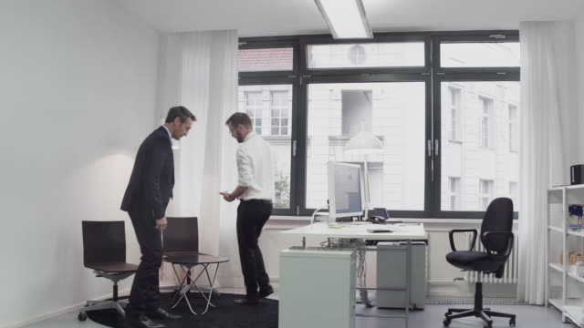Two business men meeting in an office