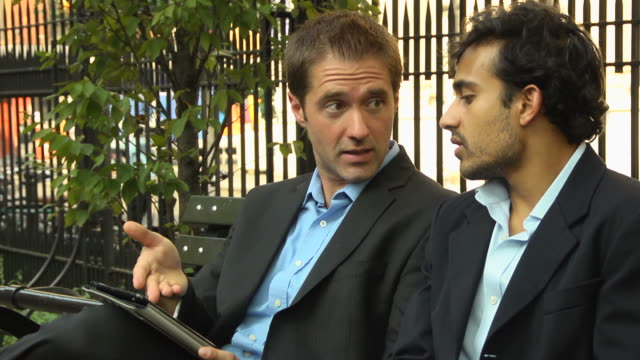 Two Businessmen Brainstorming on a Digital Tablet Computer