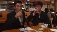 MS, Two businessmen having drinking beer in Japanese restaurant