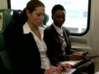 MS, Two businesswomen working in train, Chappaqua, New York State, USA