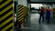 Two Car washmen walking at underground parking