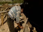 Two carpenters build a replica of Noah's Ark.