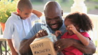 MS Two children surprising their father with Father's Day present / Richmond, Virginia