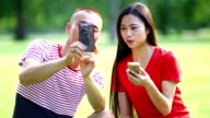 Two Chinese people having fun in park