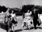 Two couples arrive at the Coronation holiday camp on Hayling Island and are greeted by the camps host 1948